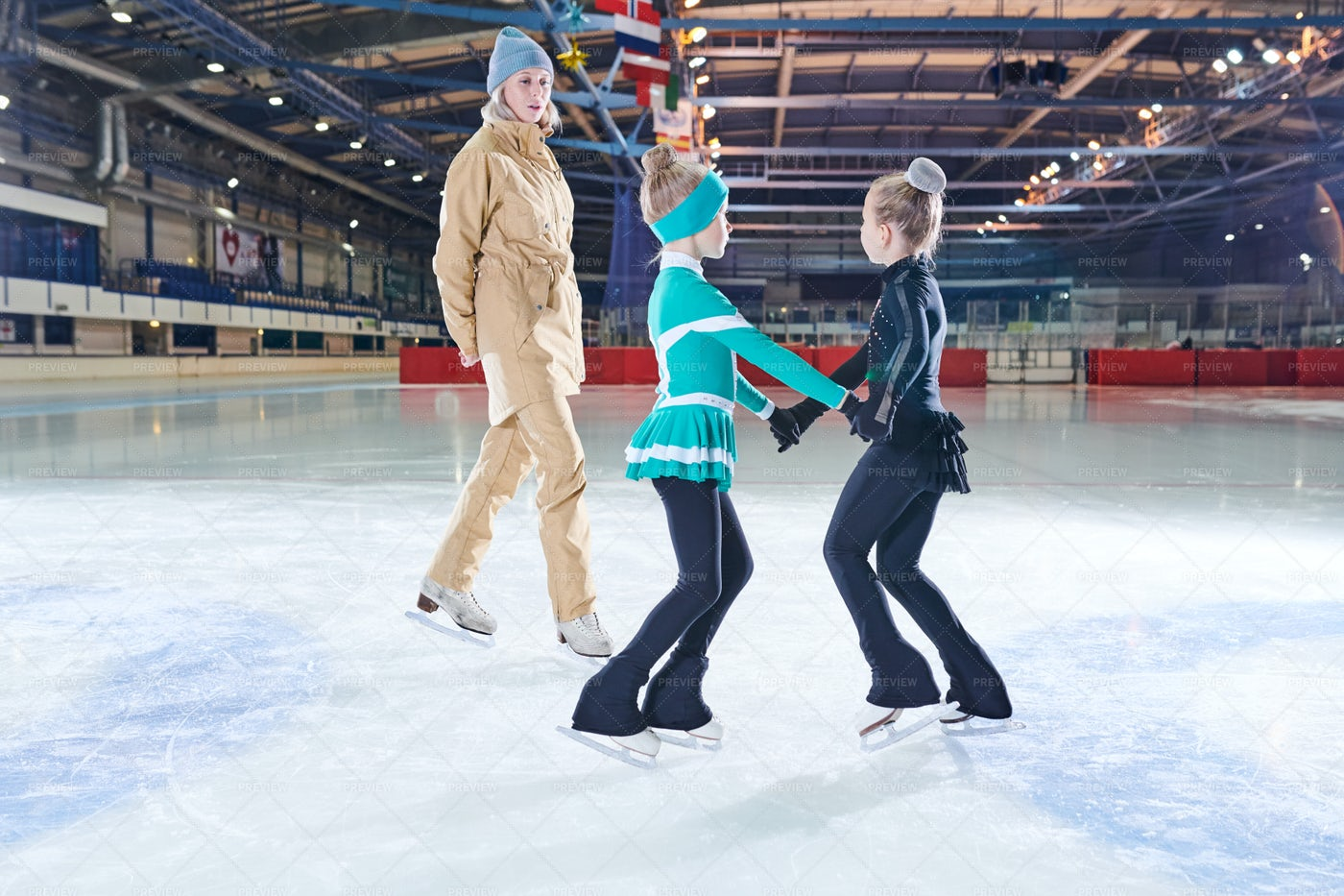 Two Girls Figure Skating Together: Stock Photos