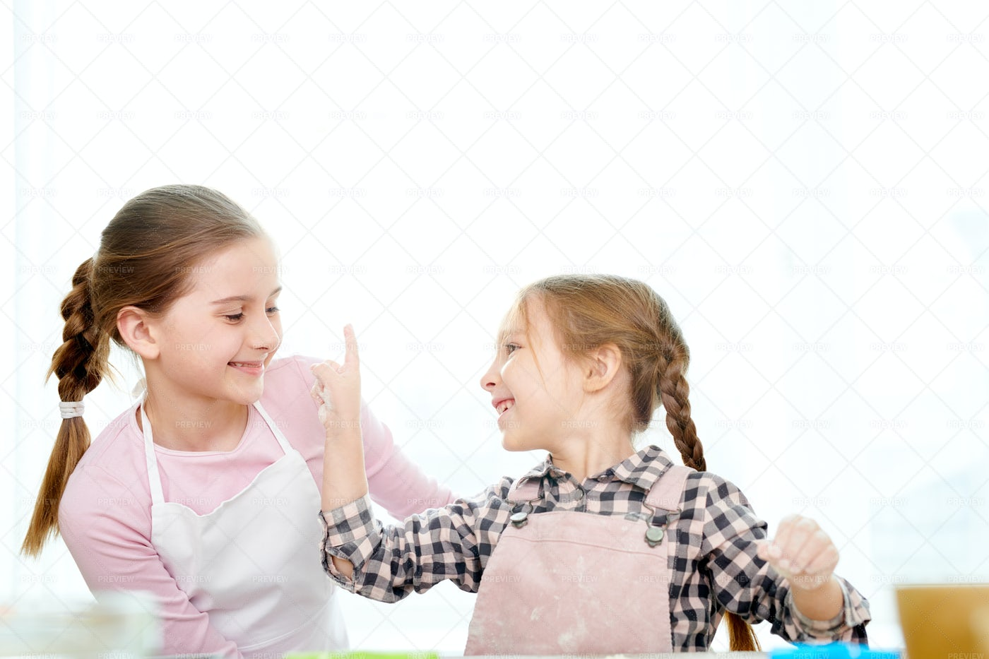 Adorable Sisters Cooking Together: Stock Photos
