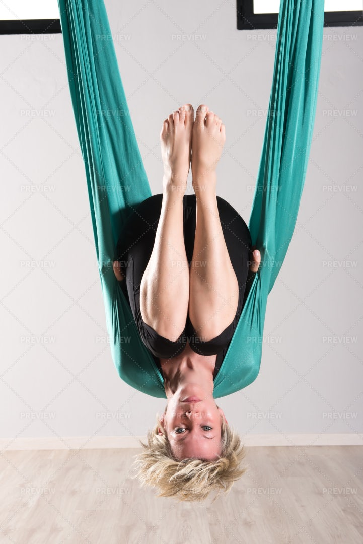 Hanging Upside Down In Aerial Yoga: Stock Photos