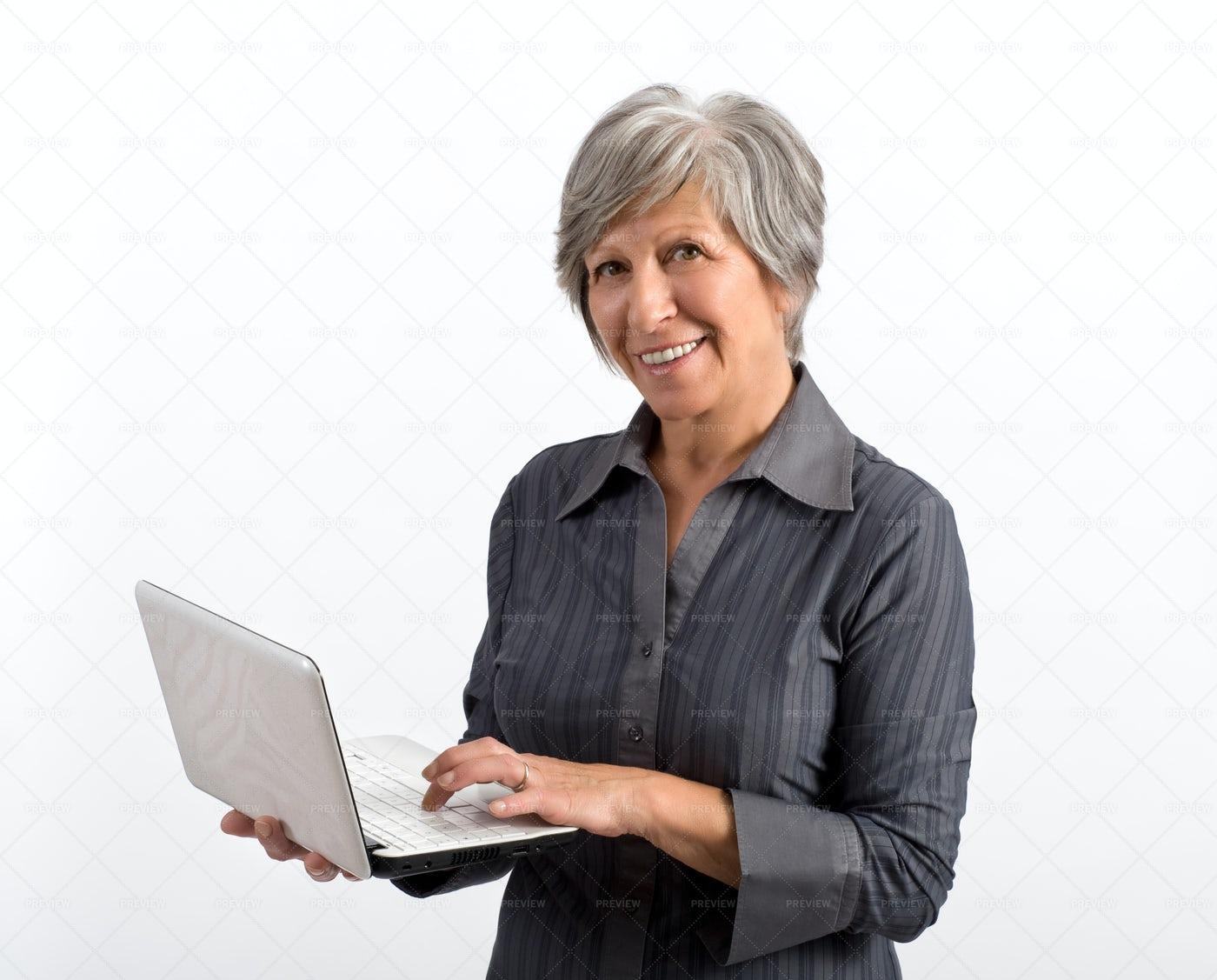 Older Woman Using Laptop: Stock Photos