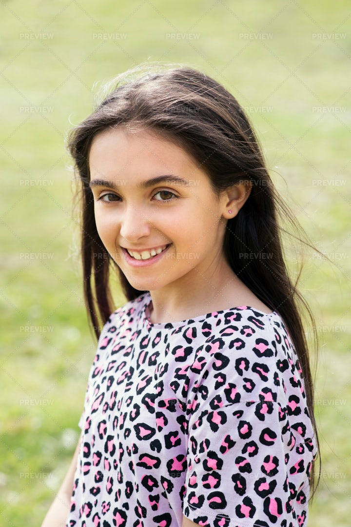 Young Girl Smiling Outdoors: Stock Photos