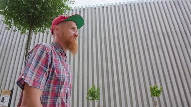 Young Redhead Walks The Street: Stock Video