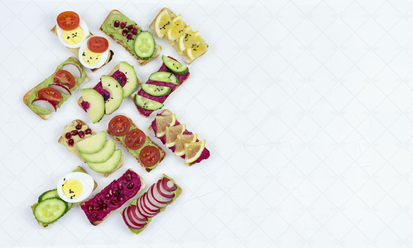 Hummus And Guacamole Bruschettas: Stock Photos