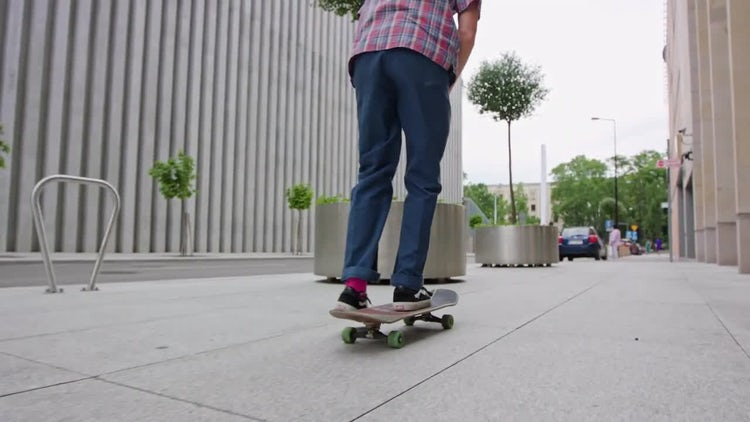 Hipster On A Skateboard: Stock Video