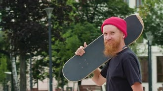 Hipster In Hat With A Skateboard: Stock Video