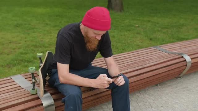 Redhead Hipster With Phone And Skateboard: Stock Video
