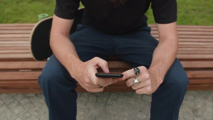 Hipster With A Smartphone In Hand: Stock Footage