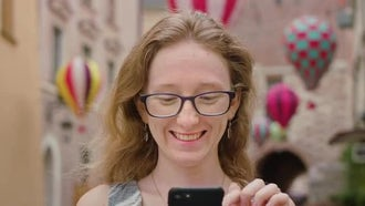 Woman Using A Mobile Phone Outdoors: Stock Video