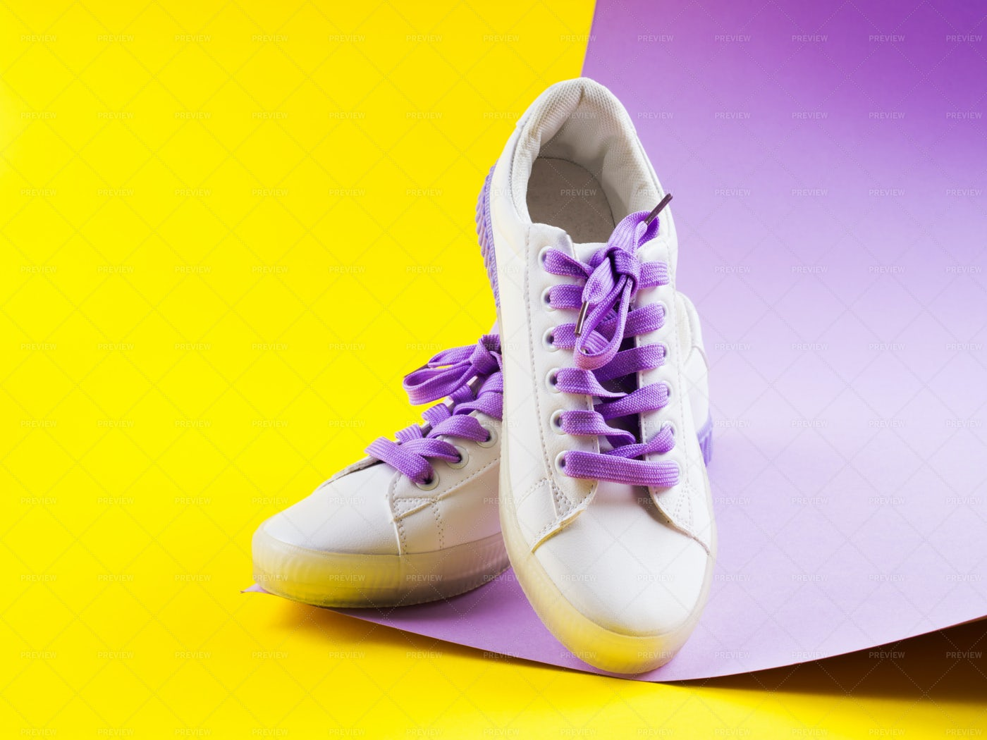 Sneakers With Purple Laces: Stock Photos