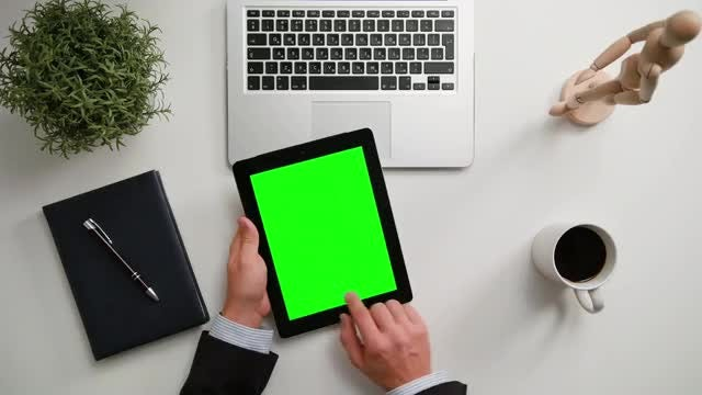 Man With iPad And Green Screen: Stock Video