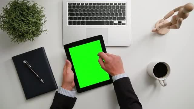 Man on a iPad with Green Screen: Stock Video