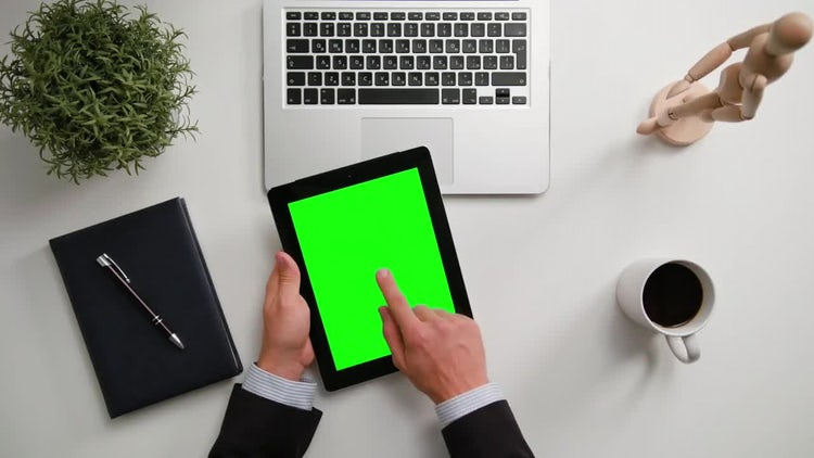 Man On A IPad With A Green Screen: Stock Video