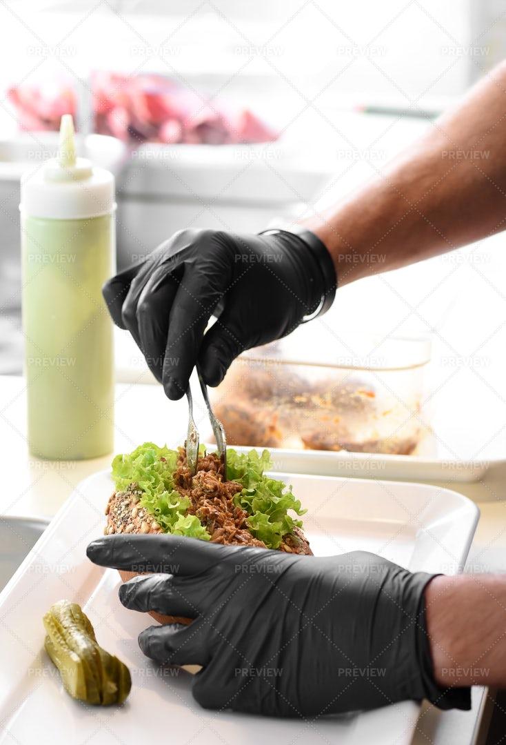 Chef Preparing Pork Sandwich: Stock Photos