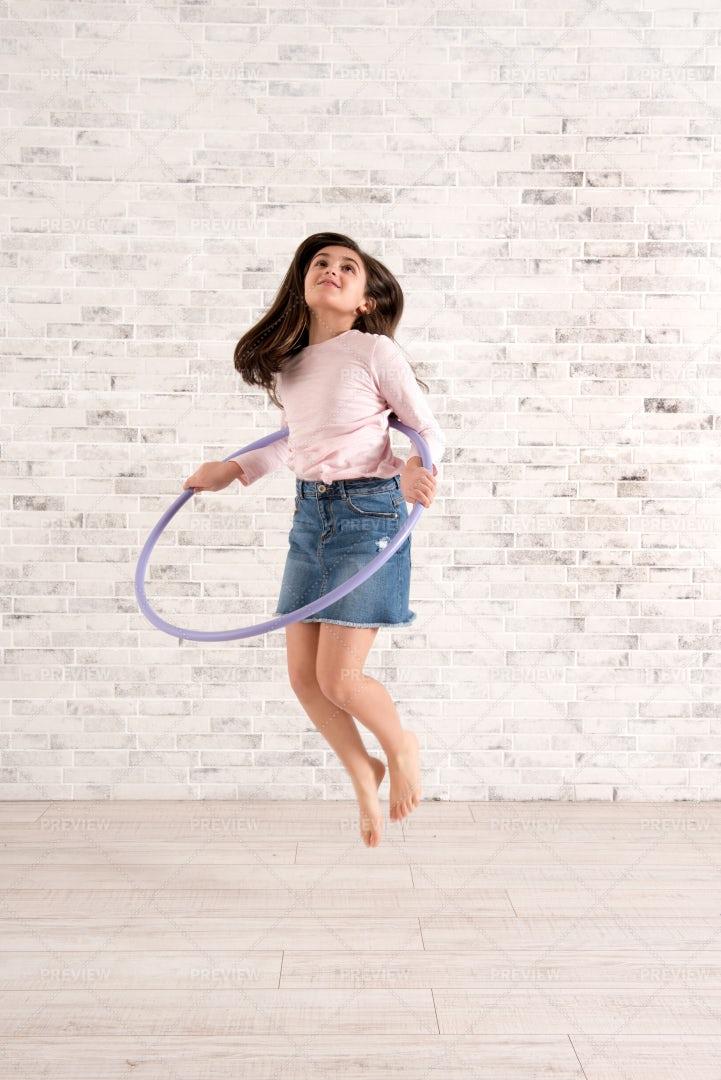 Jumping With A Hula Hoop: Stock Photos