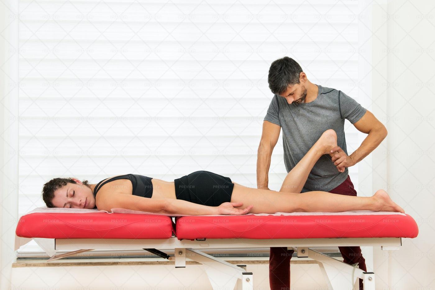 Osteopath PerformsHamstring Manipulation: Stock Photos