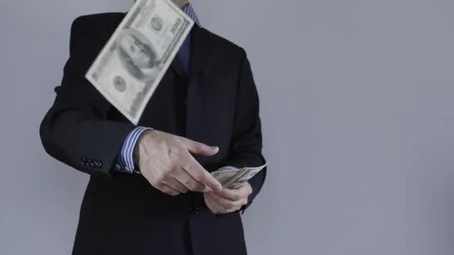 Businessman Throwing Money: Stock Video