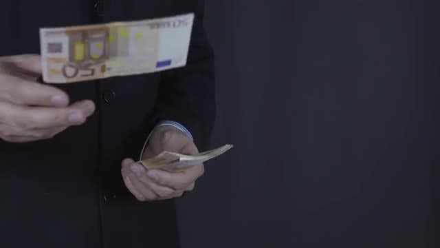 Throwing Euros: Stock Video