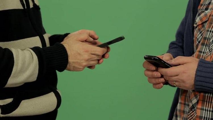 Two Men Using Smartphones: Stock Video