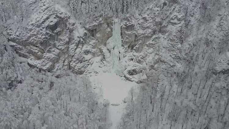 Men Climbing A Frozen Waterfall: Stock Video