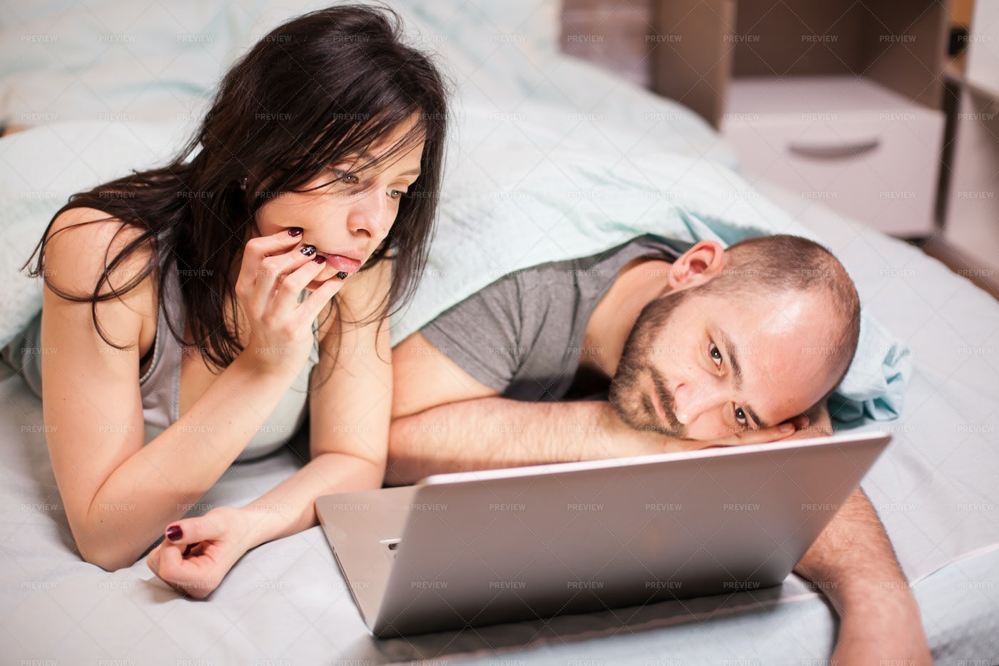 Bored Couple Watching A Movie: Stock Photos