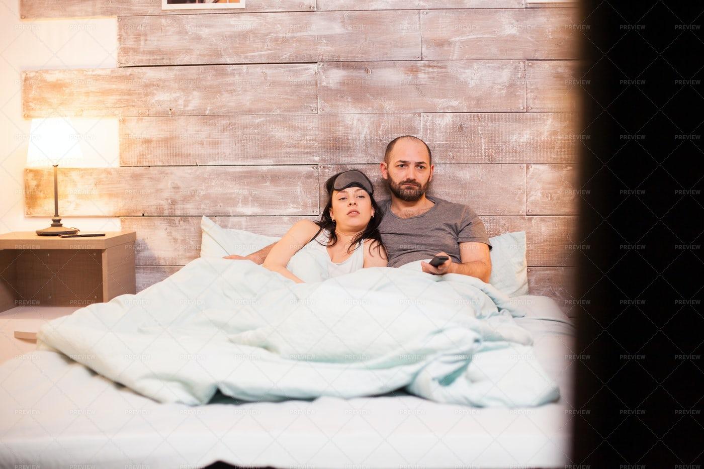 Couple Watching TV At Night: Stock Photos