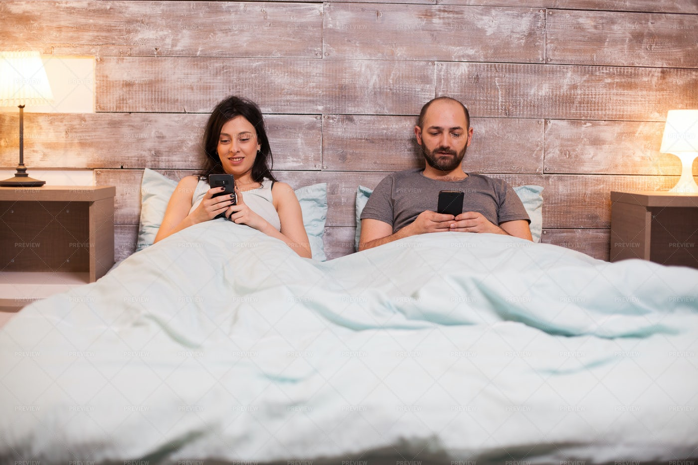 Browsing Smartphones In Bed: Stock Photos