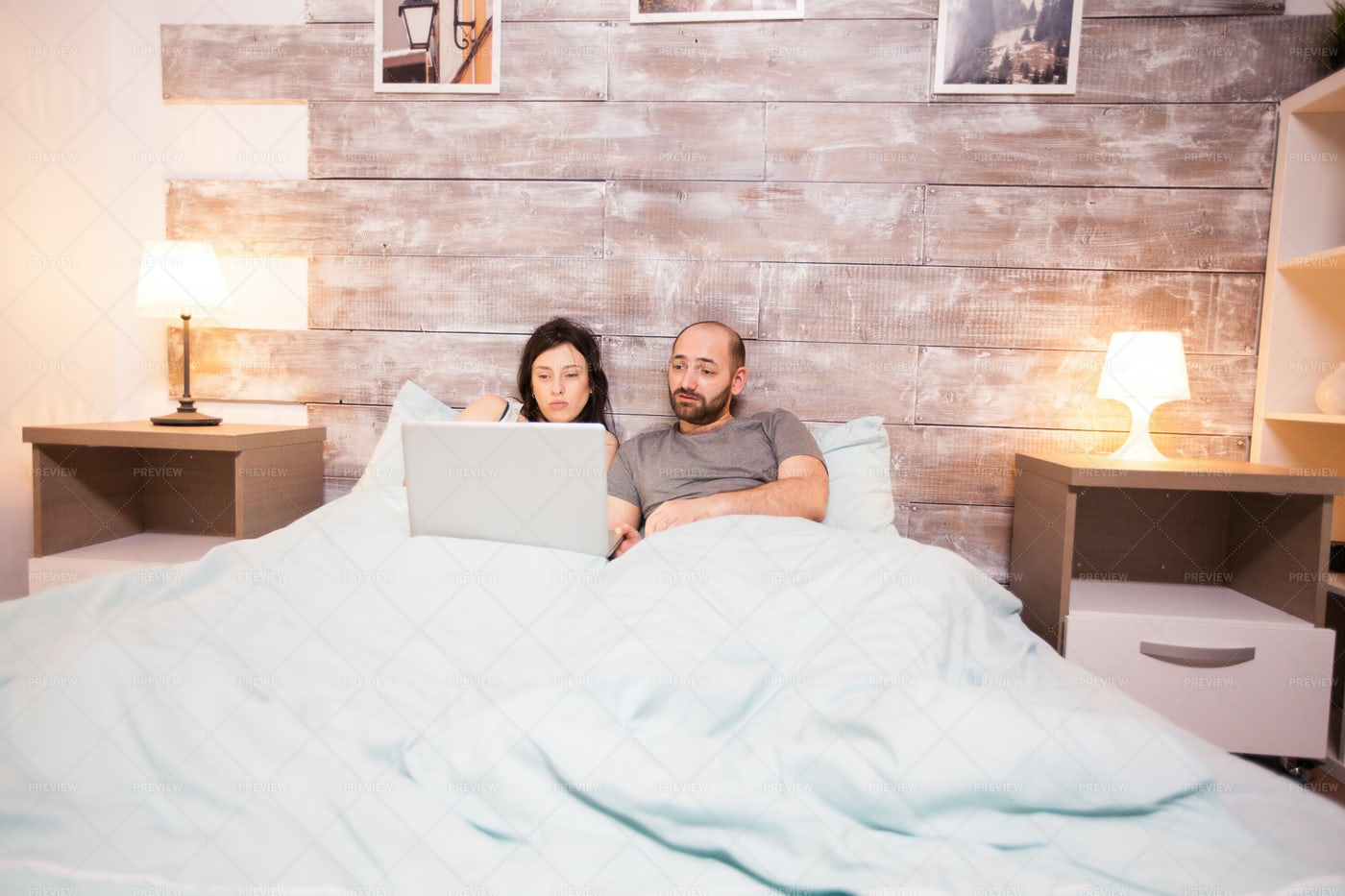 On A Laptop In Bed: Stock Photos