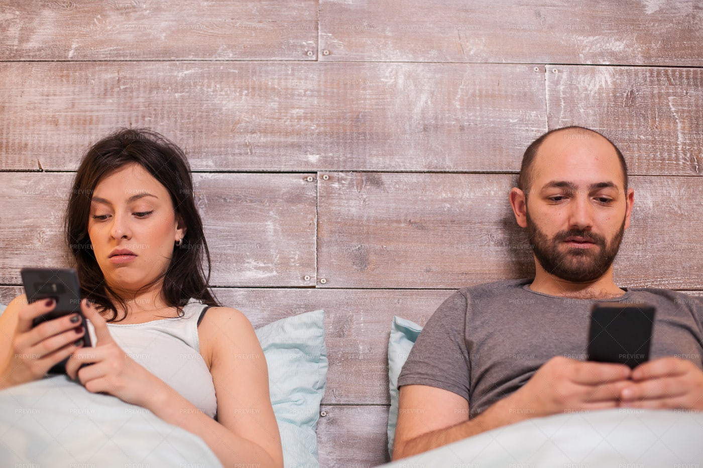 Using Smartphone In Bed: Stock Photos