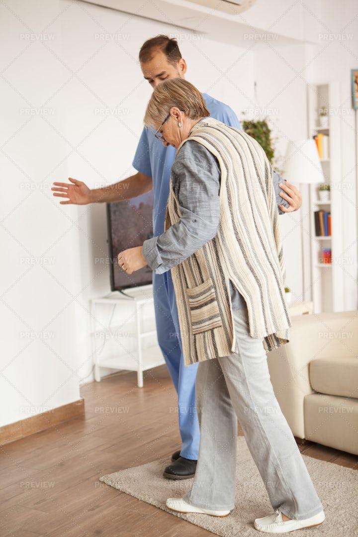 Helping An Old Woman Walk: Stock Photos