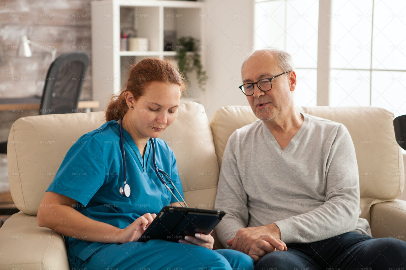 Helping Man To Use Tablet: Stock Photos