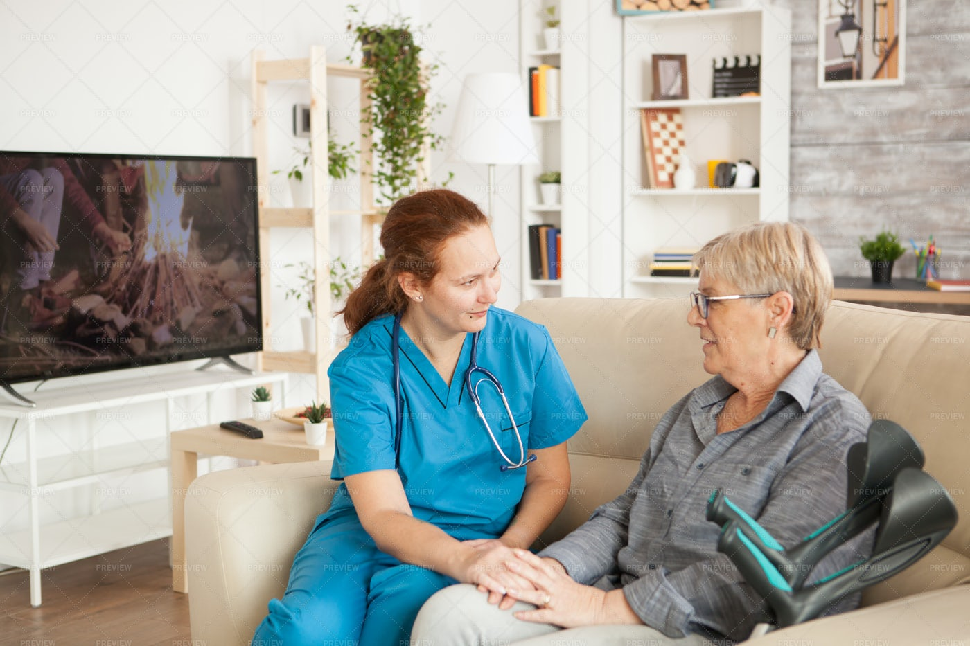 Nurse Listening The Old Woman: Stock Photos