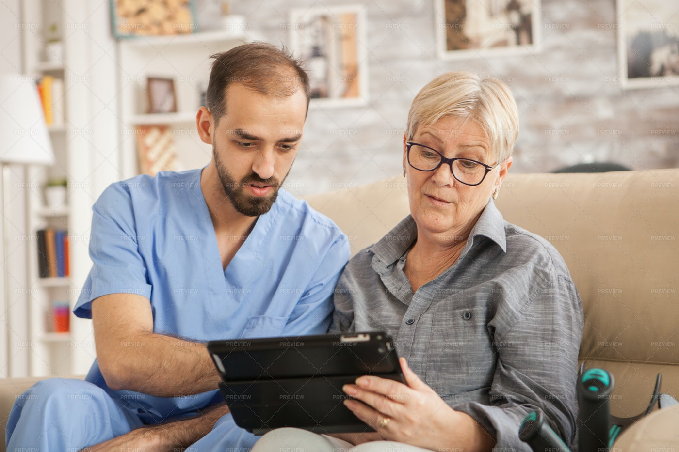 Doctor Helping Old Patient: Stock Photos