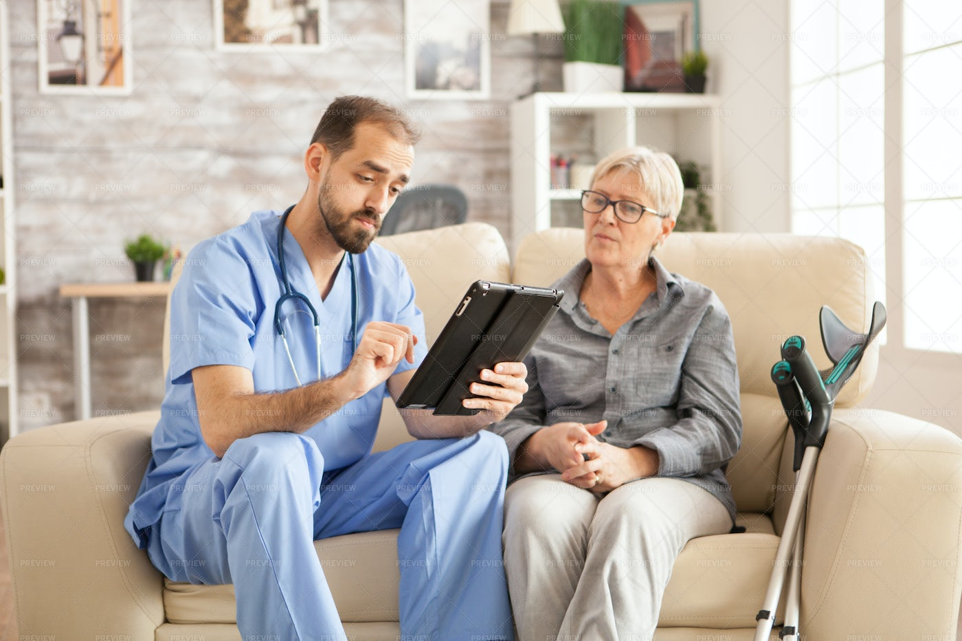 Nurse Reads From A Tablet: Stock Photos