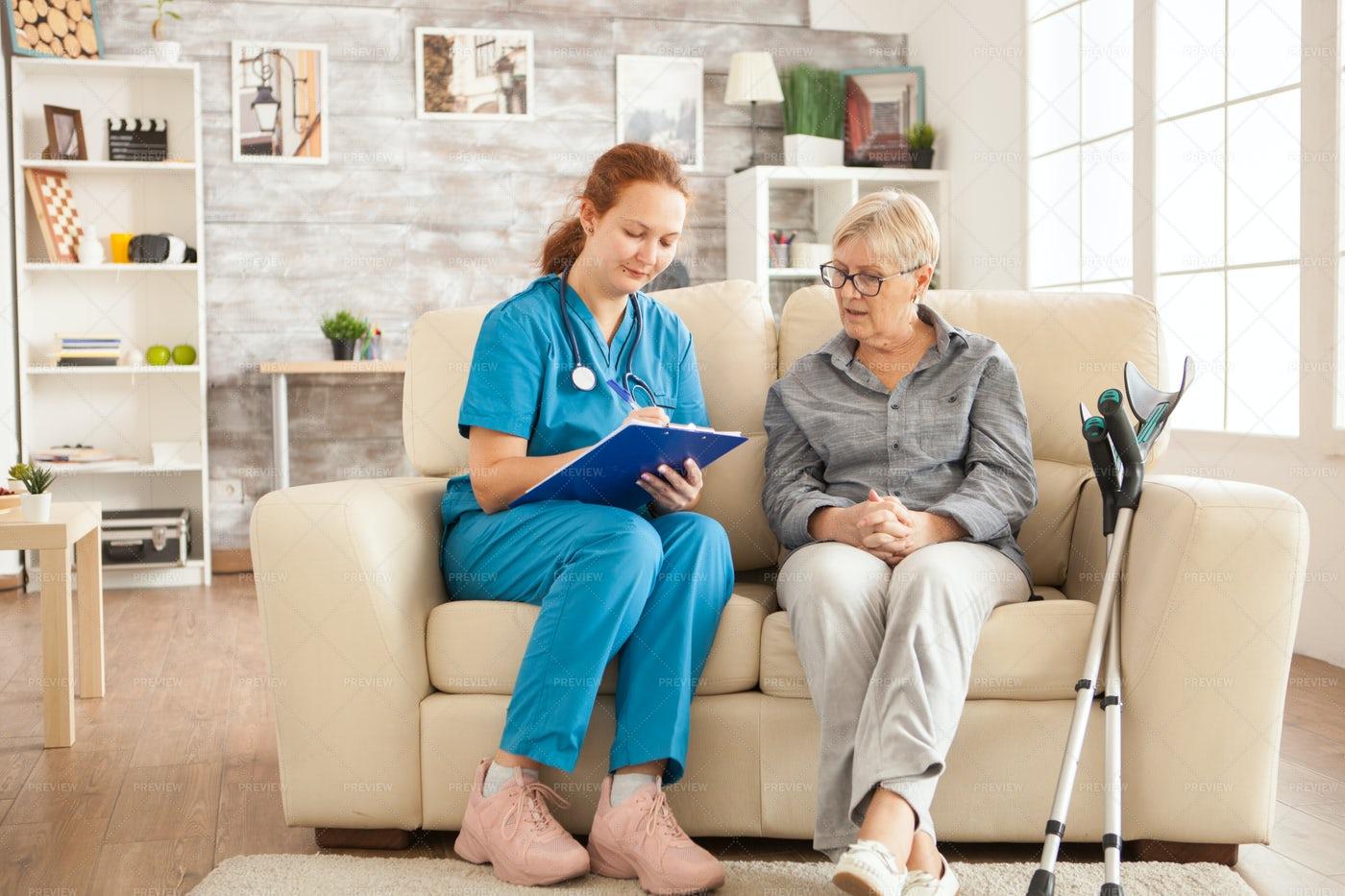 Caregiver Taking Notes: Stock Photos