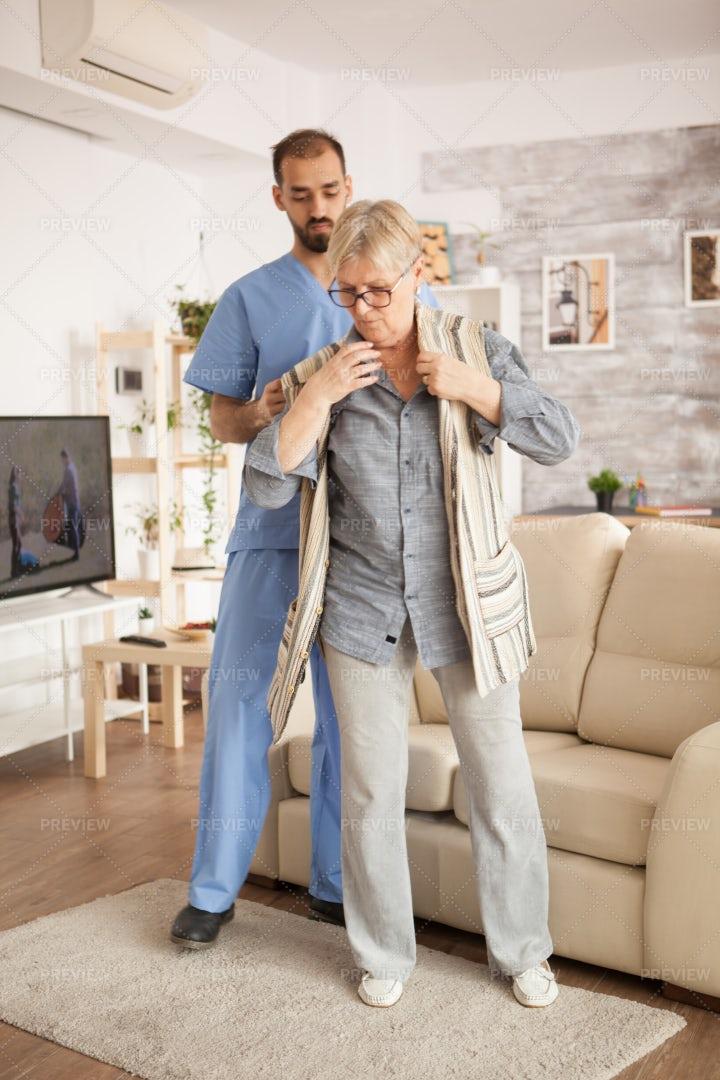 Caregiver Helping Patient: Stock Photos