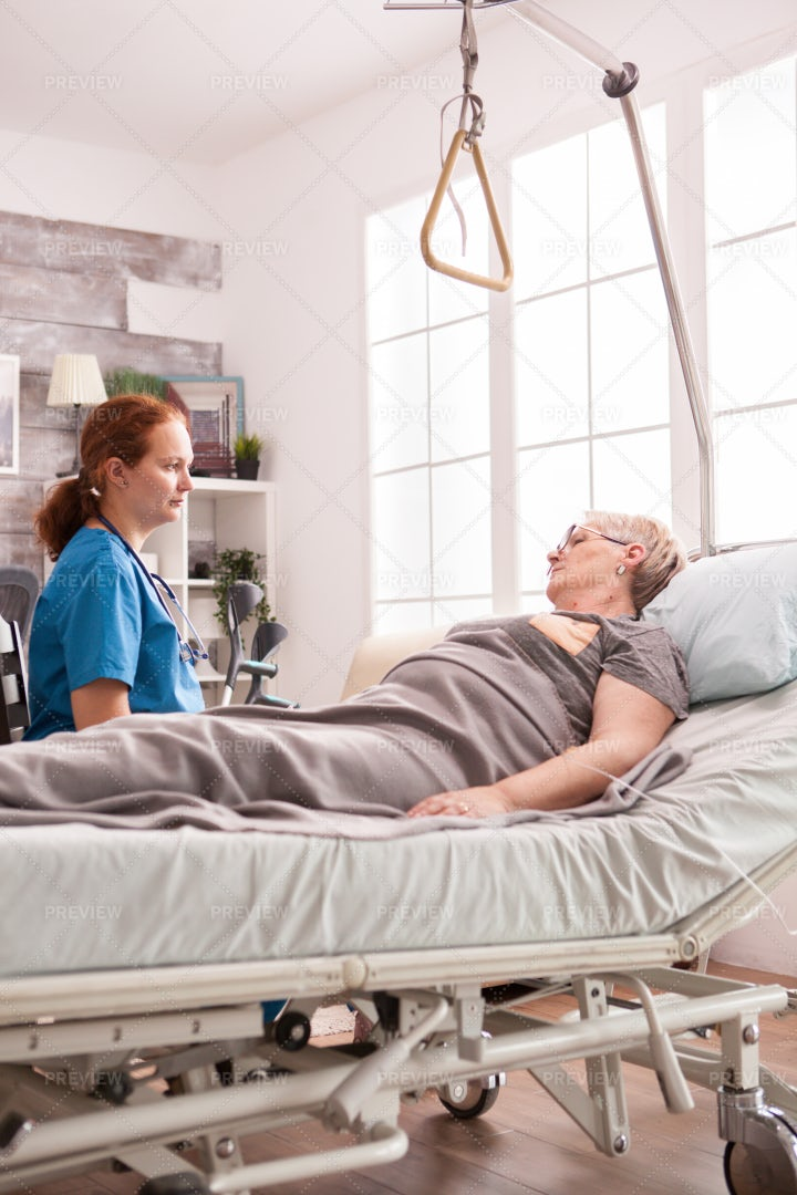 Nurse Chatting With Patient: Stock Photos