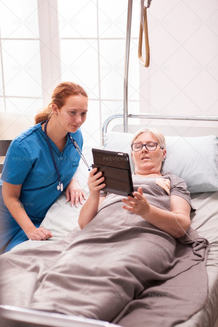 Old Woman Reads A Tablet: Stock Photos