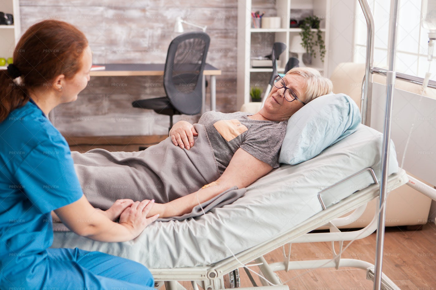 Nurse Supports An Old Woman: Stock Photos