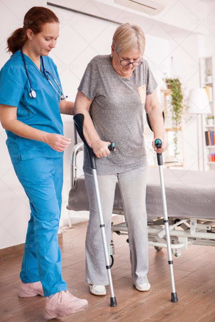 Helping  Woman With Crutches: Stock Photos