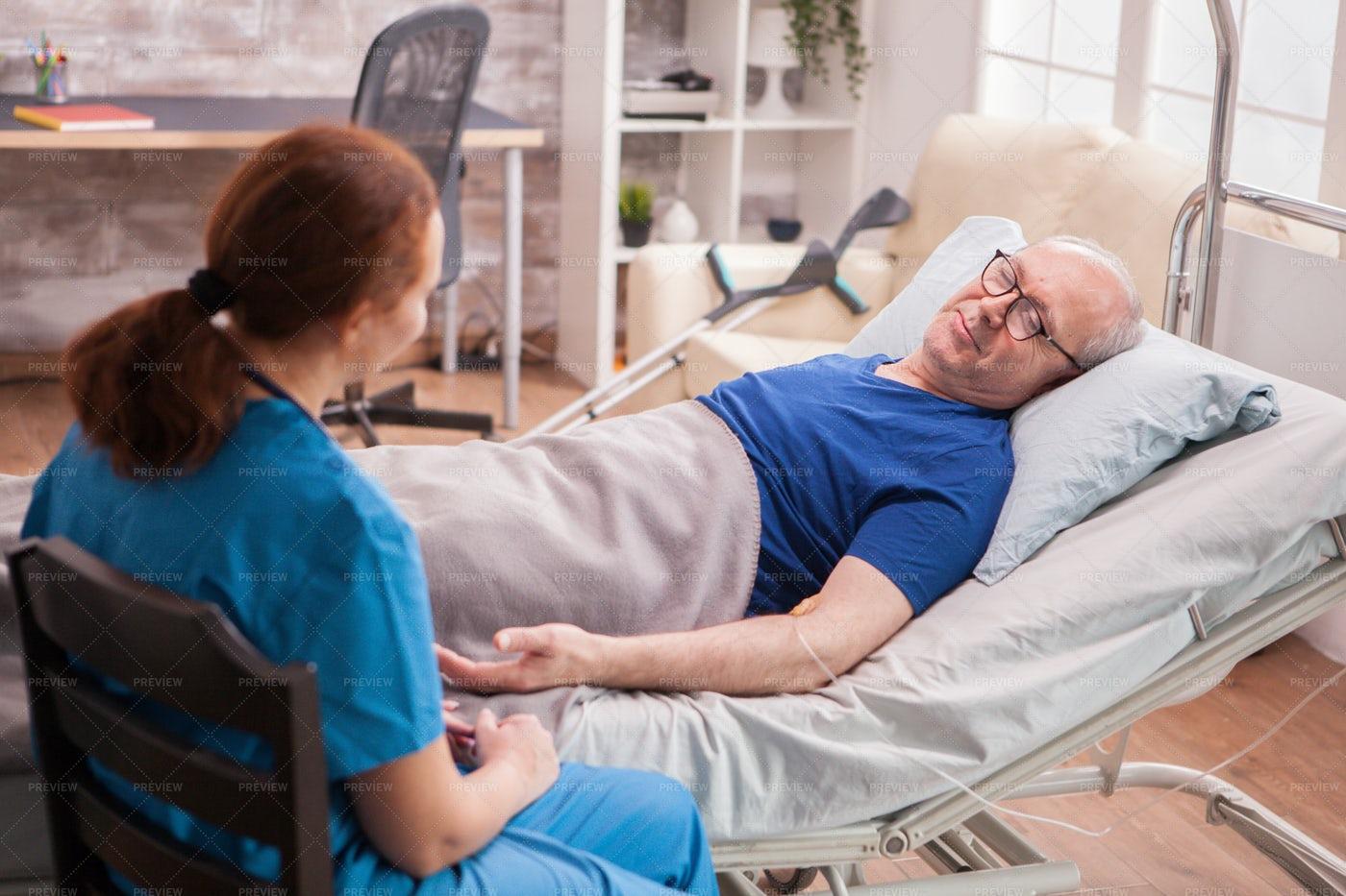 Doctor Listening An Old Man: Stock Photos