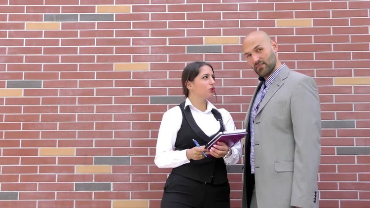 Business Man And Woman Talk: Stock Video