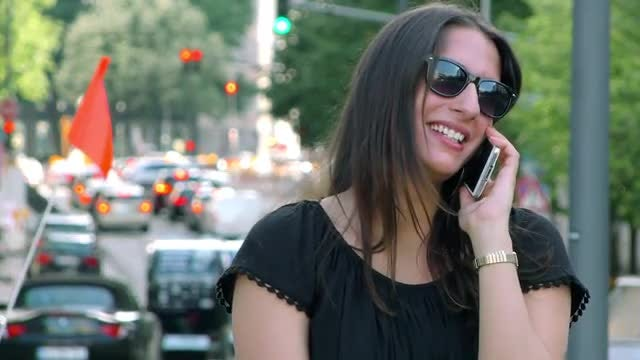Woman on Cellphone Talking and Smoking: Stock Video