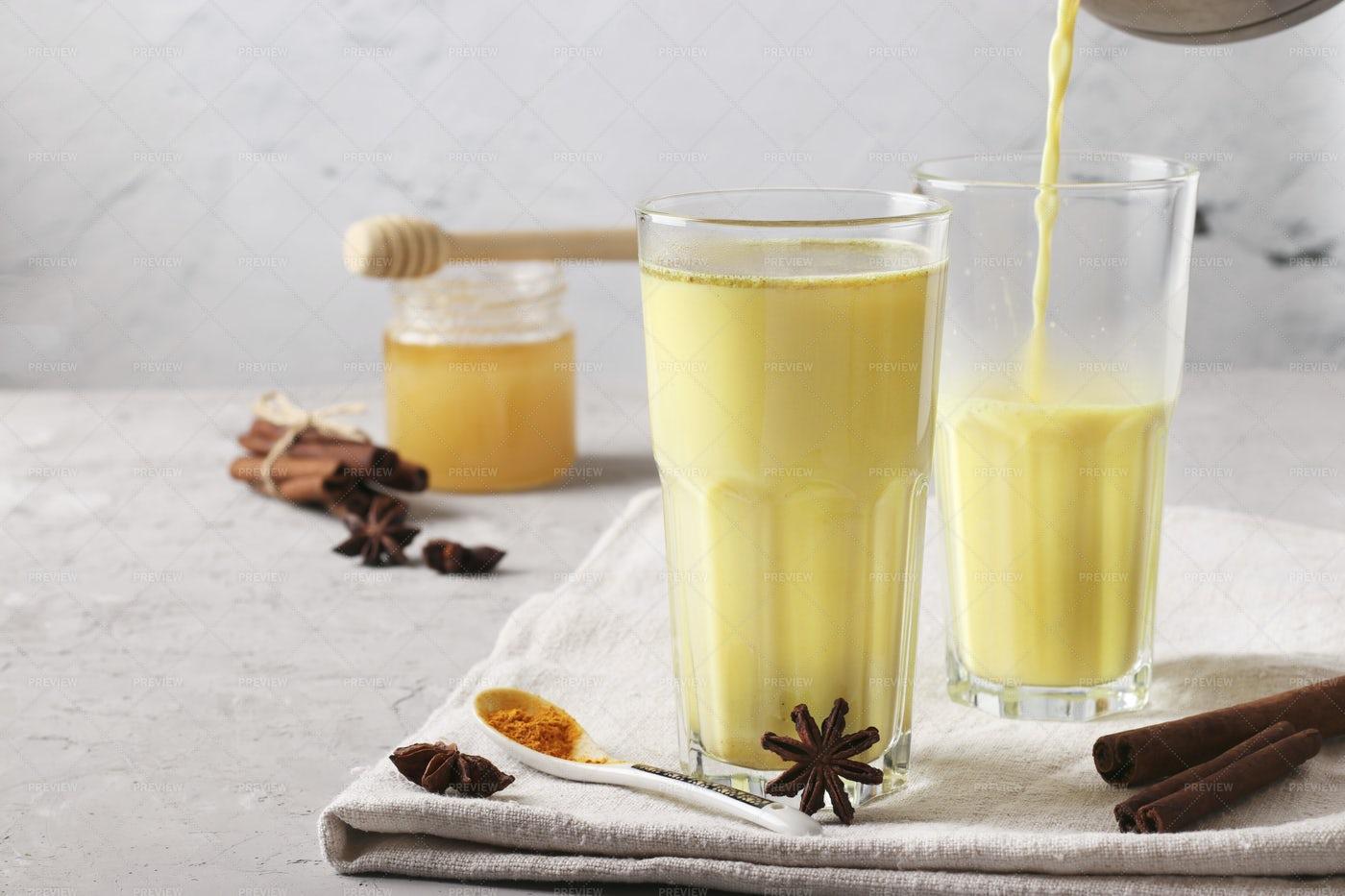 Pouring Golden Milk: Stock Photos