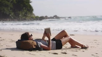Young Woman Using Tablet PC on the Beach: Stock Video