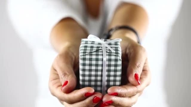Young Girl in Blur Showing Gift Box on Her Hand: Stock Video