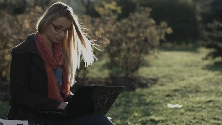 Woman With Laptop In City Park: Stock Video