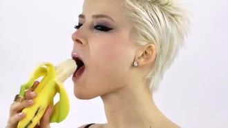 Blond Woman is Eating Banana: Stock Video