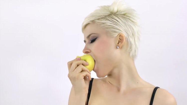 Blonde Woman Is Eating Apple: Stock Video