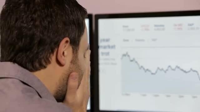 Businessman Checking Stock: Stock Video