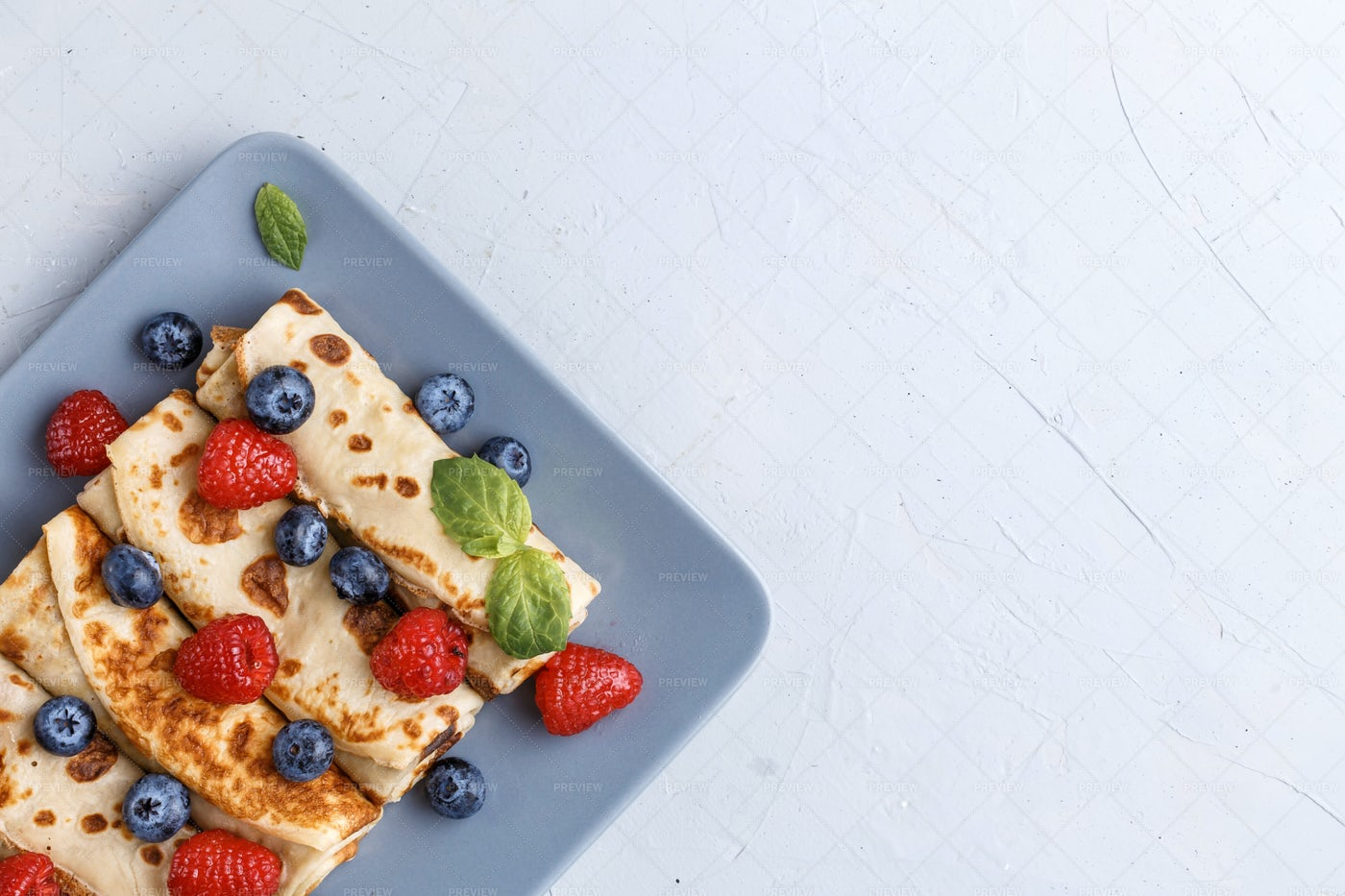 Thin Pancakes With Berries: Stock Photos